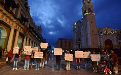 Journalists hold signs demanding the safe return of colleague Moises Sanchez during a protest in Xalapa Jan. 7, 2015. Sanchez, who writes and takes photographs for a local daily, was taken from his home by gunmen on Jan. 2, according to local media.