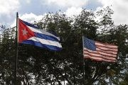 The Cuban flag and the U.S. flag fly next to one another in Havana on December 19, 2014