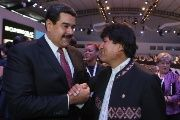 Venezuelan President Nicolas Maduro greets his Bolivian counterpart, Evo Morales, at the closing of the 3rd CELAC summit on Jan. 29, 2015.