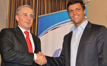 Leopoldo Lopez (R) with former Colombian President Alvaro Uribe (L). Uribe, whose administration was marred by human rights abuses, has been accused of having links with paramilitary death squads.