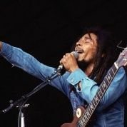 Bob Marley raises a clenched fist during a concert in Massachusetts.