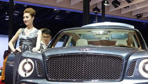 A visitor looks at the Bentley EXP 9 F SUV concept car at Auto China.