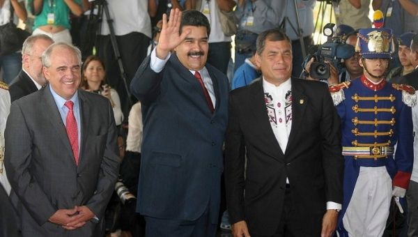 Nicolas Maduro (centre) with Rafael Correa (right) and Ernesto Samper (left) in Quito for the opening ceremony of the new UNASUR Headquarters Dec. 5, 2014.