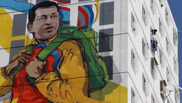 A massive mural of late Venezuelan President Hugo Chavez is seen on the wall of a new housing building built by the Venezuelan government, Feb. 8, 2015.