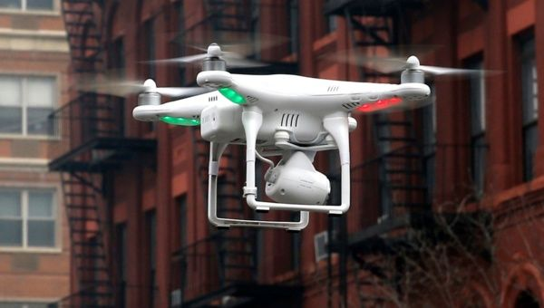 A camera drone operated by a civilian flies near the scene where two buildings were destroyed in an explosion in New York, in this file photo taken March 12, 2014.