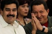 Venezuela's President Hugo Chavez (R) gestures next to Nicolas Maduro. Both democratically-elected presidents of Venezuela have been the victims of ongoing attacks by the U.S. media.