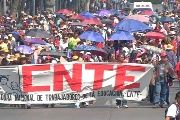Dissident teachers marching down Mexico City's Reforma Avenue