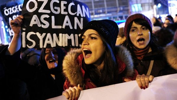 A woman shouts slogans during a demostration in Istanbul against the murder of a young woman named Ozgecan Aslan.