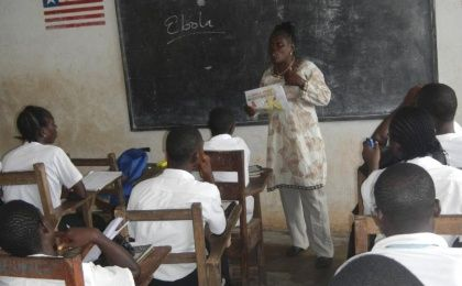 A teacher speaks about the Ebola virus to students in Foya, Liberia, in 2014