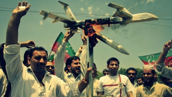 A protest in Pakistan burn mock drones.