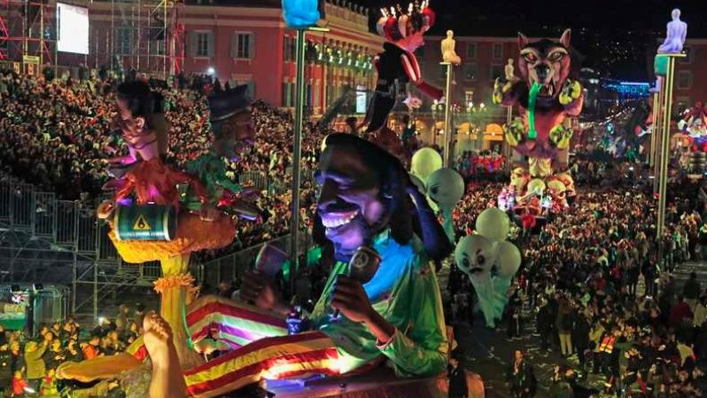 A float with a giant figure of late singer Bob Marley (C) is paraded through the crowd during the Carnival parade in Nice, Feb. 17, 2015.