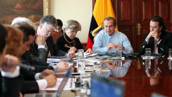 Ecuadorean Foreign Minister Ricardo Patiño (c) is seated next to the executive secretary of CEPAL, Alicia Barcena, during a meeting on Feb. 19, 2015.