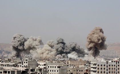Smoke rises after what activists said were air strikes by forces loyal to Syria