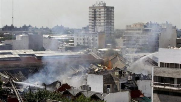 Firefighters work to put out a blaze at an Iron Mountain warehouse in the Barracas neighborhood of Buenos Aires, Argentina.