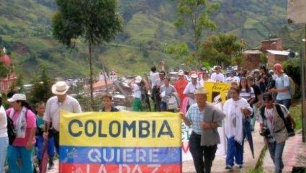La distribución de la tierra es una de las causas estructurales de la guerra en Colombia.