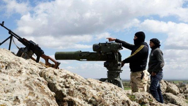 """A rebel fighter of the Free Syrian Army, one of the so-called """"moderate"""" rebel groups."""