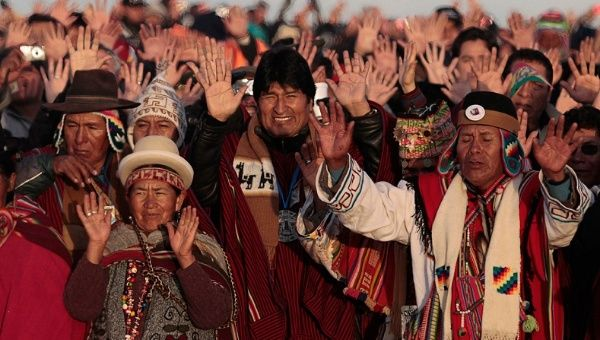 Bolivia's President Evo Morales (center) celebrates the sunrise during a winter solstice ceremony in Tiwanaku, on June 21, 2011.