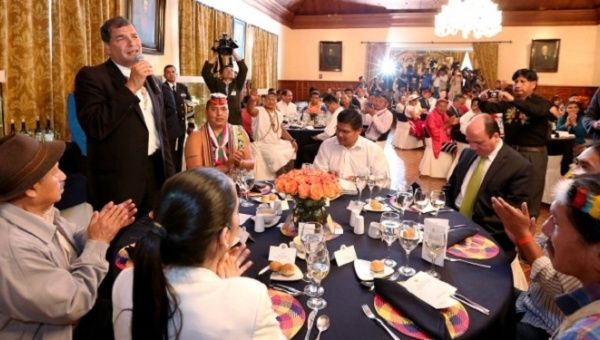 Ecuadorean President Rafael Correa meets with grassroots indigenous leaders in the presidential palace in Quito, March 16, 2015.