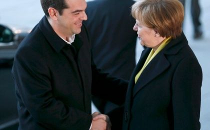 German Chancellor Angela Merkel shakes hands with Greek Prime Minister Alexis Tsipras during a welcoming ceremony at the Chancellery in Berlin, March 23, 2015.
