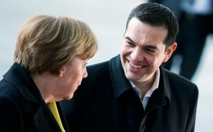 German Chancellor Angela Merkel and Greek Prime Minister Alexis Tsipras talk during a welcoming ceremony at the Chancellery in Berlin, March 23, 2015.