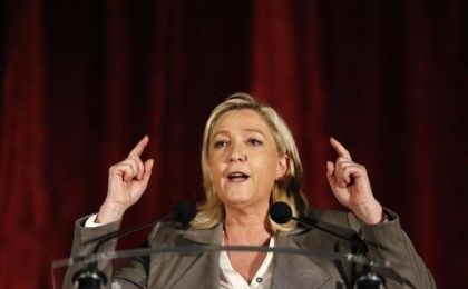 France's far-right National Front leader Marine Le Pen gestures as she speaks during a political rally as part of the campaign for the second round in the French local elections in Henin-Beaumont, northern France, March 25, 2015.