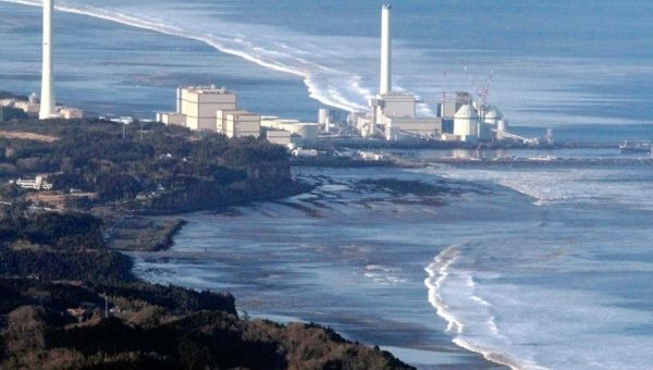 Hirono Power Station is seen as a wave approaches after an earthquake in Fukushima Japan, March 11, 2011.
