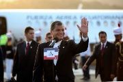 Ecuadorean President Rafael Correa waves after arriving in Panama ahead of the Summit of the Americas, April 10, 2015.