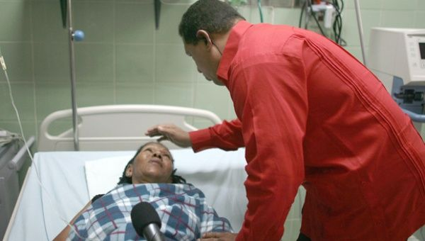 The late Hugo Chavez is shown visiting a Barrio Adentro II facility. Under Chavez, Barrio Adentro became the most significant expansion of the Venezuelan public health care system in decades.