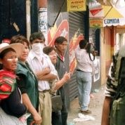 Street vendors protesting against a 20 percent increase in the cost of water yell at riot police in 2000, in Cochabamba, Bolivia.