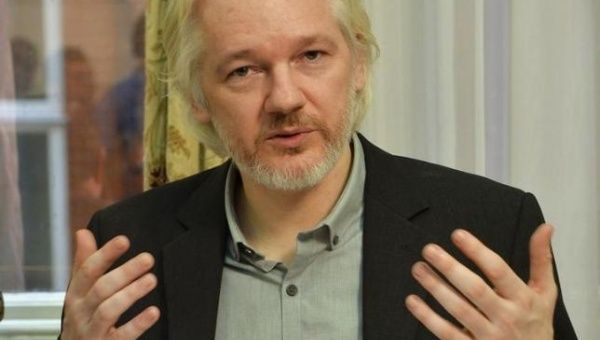 Julian Assange has signed a letter condemning Obama