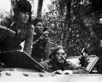 Cuban leader Fidel Castro (lower right) sits inside a tank near Playa Giron, Cuba, during the Bay of Pigs invasion, April 17, 1961.