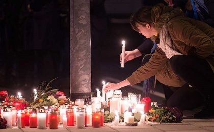 Candles have been lit in various places to remember the victims of Germanwings flight that crashed in the French Alps.