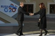 Russian President Vladimir Putin (L) welcomes Argentina's President Cristina Fernandez de Kirchner at the start of the G-20 summit on September 5, 2013 in Saint Petersburg.