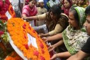 Bangladeshi people lay floral wreaths in memory of the victims of the Rana Plaza factory collapse as they mark the second anniversary of the disaster on Friday.