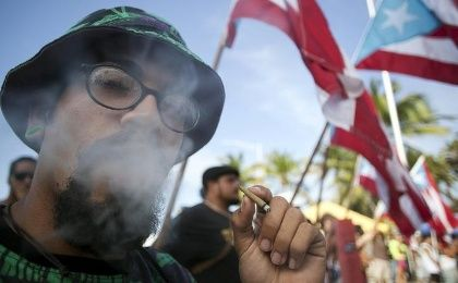 A demonstrator smokes marijuana during a protest outside Puerto Rico's Capitol building in San Juan April 20, 2015.