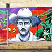 The image of Farabundo Marti appears in a mural painted by Raul Gonzalez in Los Angeles, California.