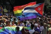 People take part in a gay pride parade during an event ahead of International Day Against Homophobia in Havana May 10, 2014.