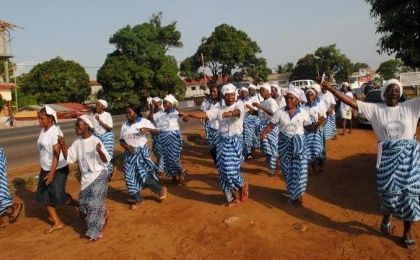 Liberian women locally referred to as 'prayer warriors' celebrate Monrovia, Liberia, after the WHO declared the country Ebola-free May 9, 2015.