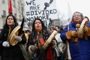 Indigenous protesters march towards Canada's parliament building in Ottawa, Jan. 11, 2013.