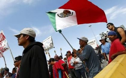 Farmworkers march during a demonstration in San Isidro on the border between the U.S. and Mexico, in Tijuana in Baja California state, March 29, 2015.