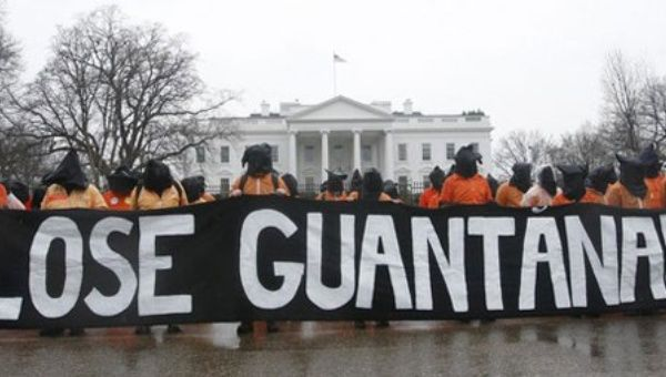 Activists protest outside the White House demanding that the government close Guantanamo Bay prison.