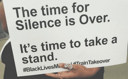 With placards, activists brought facts and figures on racial inequality to the trains