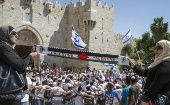 Palestinians protest Jerusalem Day marches by Israeli nationalists at Damascus Gate, in Jerusalem's Old City May 17, 2015.