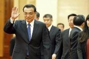Chinese Premier Li Keqiang waves before a meeting at the Great Hall of the People in Beijing, April 14, 2015.