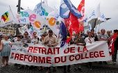 "Teachers on strike in Marseille hold a banner reading ""Remove School Reform"" on May 19, 2015."