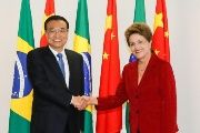 Handout photo released by the Brazilian Presidency of China's Prime Minister Li Keqiang (L) and President Dilma Rousseff shaking hands during a meeting at the Planalto Palace in Brasilia on May 19, 2015