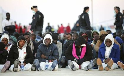 Migrants rest after they disembarked in the Sicilian harbour of Augusta, April 16, 2015.