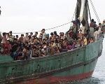 Rohingya and Bangleshi migrants wait on board a fishing boat off the coadt of Indonesia. Both groups are increasingly taking to the sea to escape conditions in their home countries.
