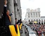President Rafael Correa greets a cheering crowd outside the Presidential Palace in Quito, Ecuador after delivering his address to the nation, May 24, 2015.