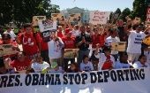 Protesters demonstrate outside the White House to demand an end to deportations and ineffective immigration policy